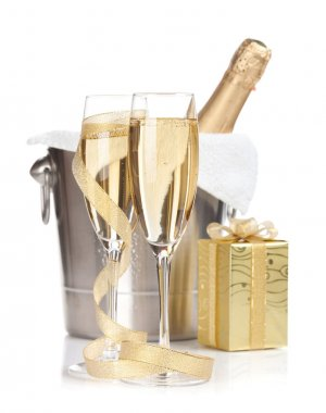 Champagne bottle, glasses and christmas gift