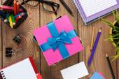 Fotografie Gift box and office supplies over office table
