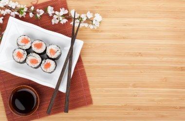 Sushi maki with salmon and sakura branch
