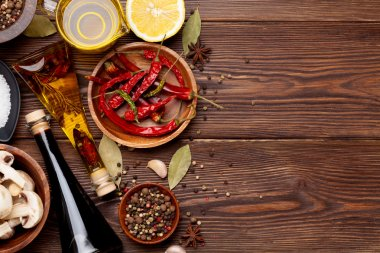 Various spices on wooden background