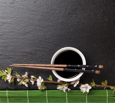 chopsticks, soy sauce and sakura blossom