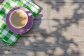 Fotografie Coffee cup on garden table