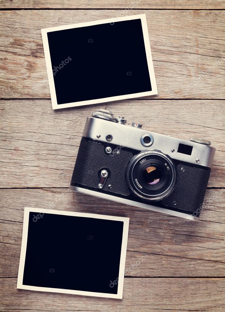 Vintage camera and blank photo frames — Stock Photo © karandaev ...