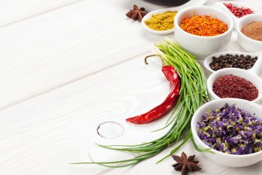 Various spices on white wooden background. Top view with copy space stock vector