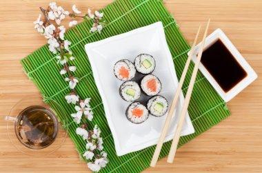 Sushi maki, green tea and sakura