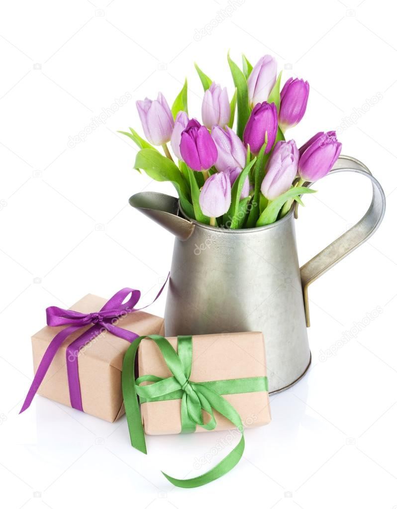 Purple tulip bouquet in watering can and gifts