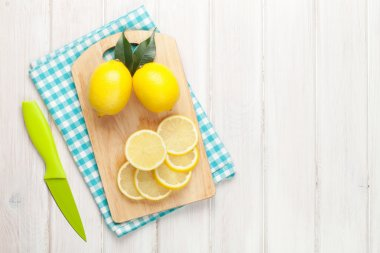 Sliced lemon on cutting board. Top view over wood table background with copy space stock vector