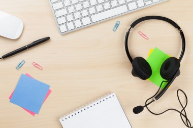 Office desk with headset.