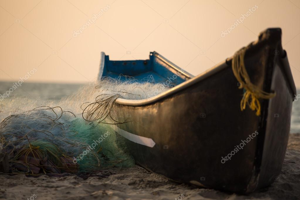 Fisherman boat with fishing nets