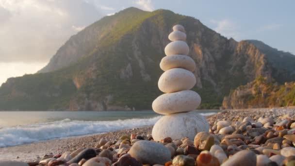 Balance stones on the Cirali beach at sunset, Turkey