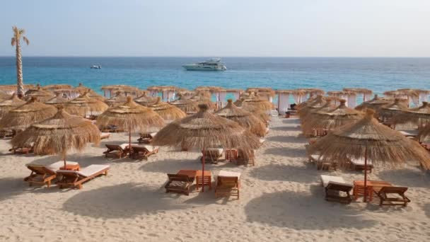 Beautiful beach with umbrellas and sunbeds