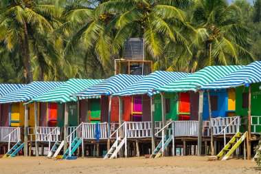 Colorful huts on sandy beach
