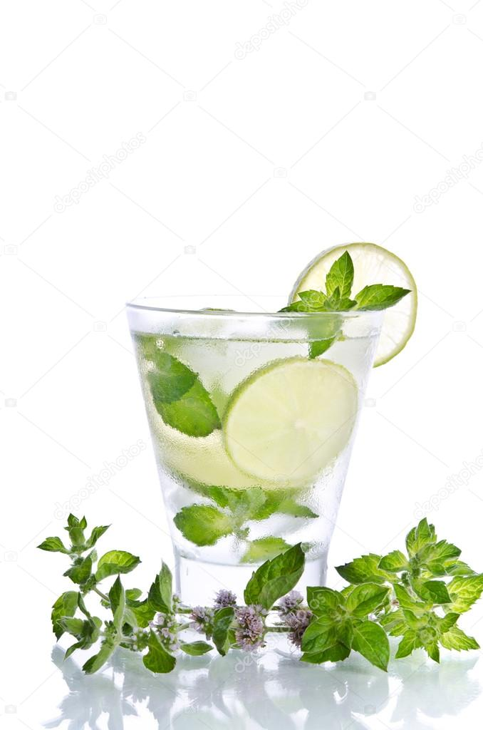 Mohito drink with ice mint and lime on white background