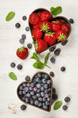Fruits and berries on white marble background