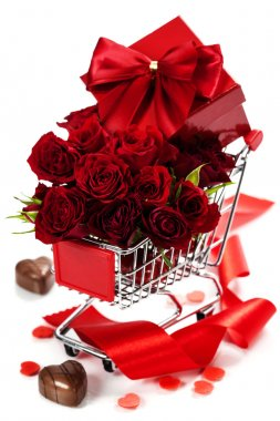 A shopping cart full with roses, chocolate and gift - Valentine's day and love concept stock vector