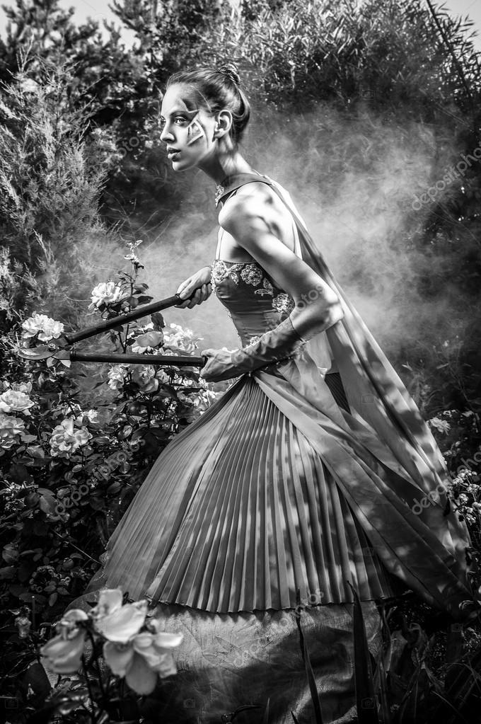Attractive romantic woman on beautiful dress pose outdoor black white fine art photo photo by innervision
