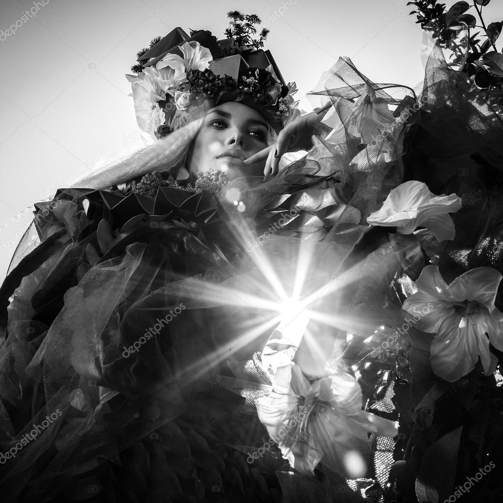 Dramatized image of sensual girl symbolizing nature. Black-white art fashion outdoor photo.