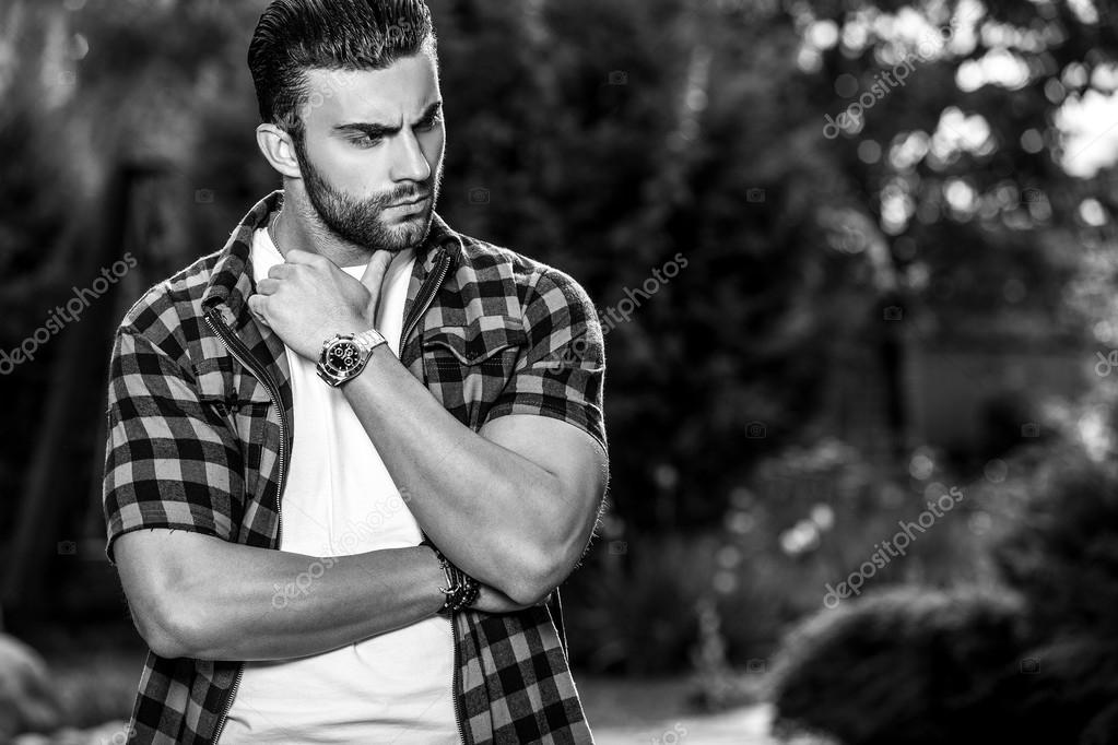 Sporty Handsome Man In Casual Clothes Poses Outdoor Stock Photo C Innervision 116745572