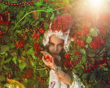 Fairy tale woman portrait surrounded with natural plants and roses. Art image in bright fantasy stylization.