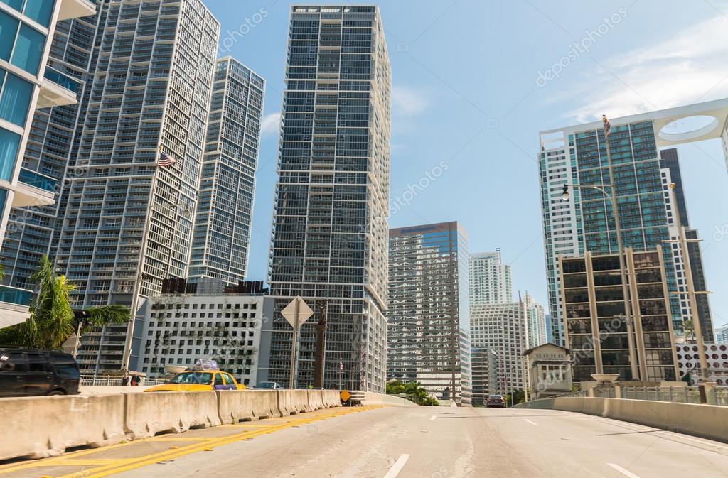 Driving in Miami, Florida. City buildings along main road