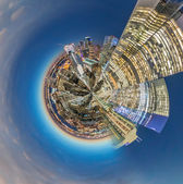 Fotografie Planet Manhattan - Miniature planet of New York skyline at night