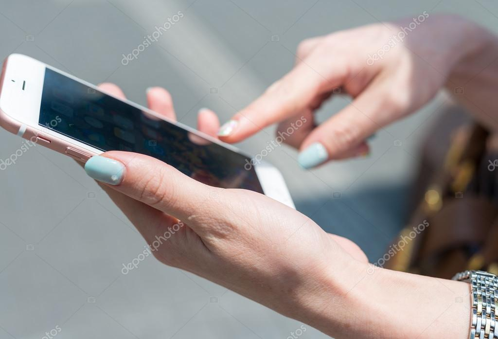 Beautiful female hands working with smartphone