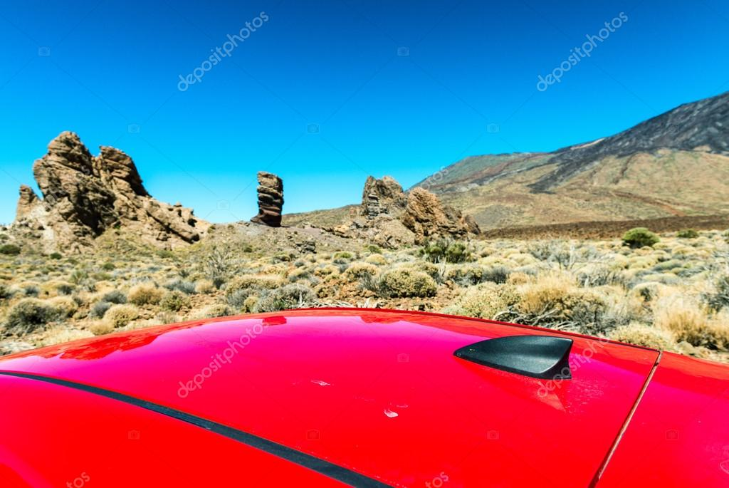 Red car roof with mountain scenario
