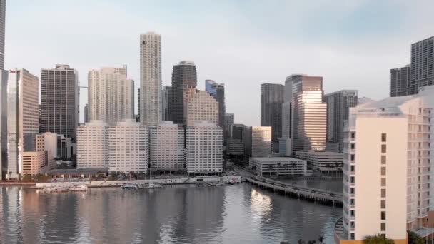 Amazing Downtown Miami aerial skyline from Brickell Key on a sunny morning, Florida in slow motion