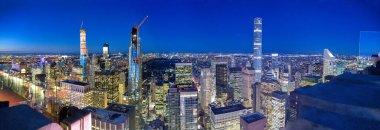 NEW YORK CITY - DECEMBER 6, 2018: Manhattan sunset skyline from city rooftop on a winter night.