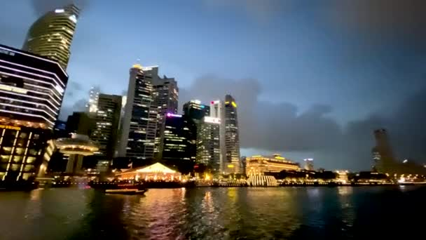 SINGAPORE - JANUARY 3, 2020: Singapore night skyline from a ferry boat cruise