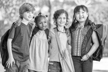 Black and white scene of happy children at school