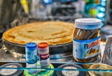 PARIS - JULY 7, 2014: Jar of Nutella on a crepe street seller. N