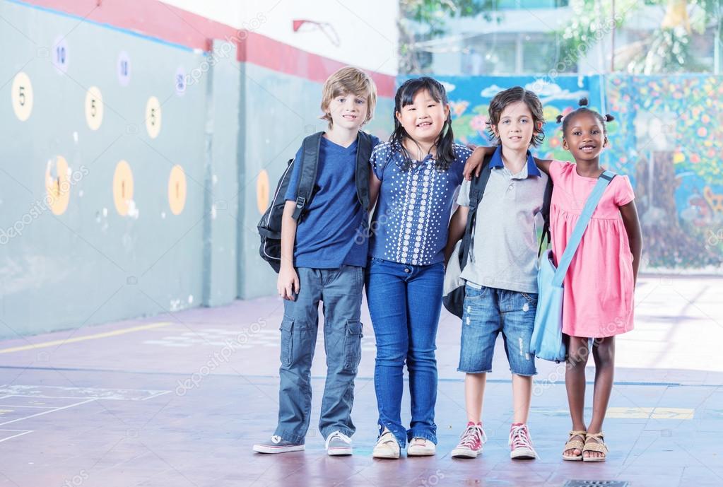 Schoolchildren embracing happy. Multi cultural racial classroom