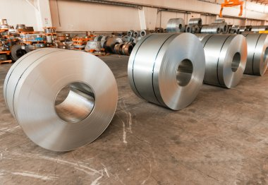 Cold rolled steel coils in storage area ready to feed to machine