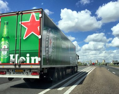 AMSTERDAM - APRIL 28, 2015: Truck on the interstate with Heineke