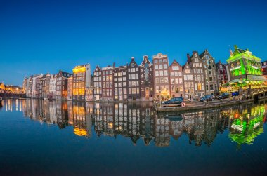 Beautiful night skyline of Amsterdam. City homes along canal