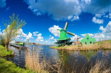 Zaanse Schans windmills along city canal, Netherlands
