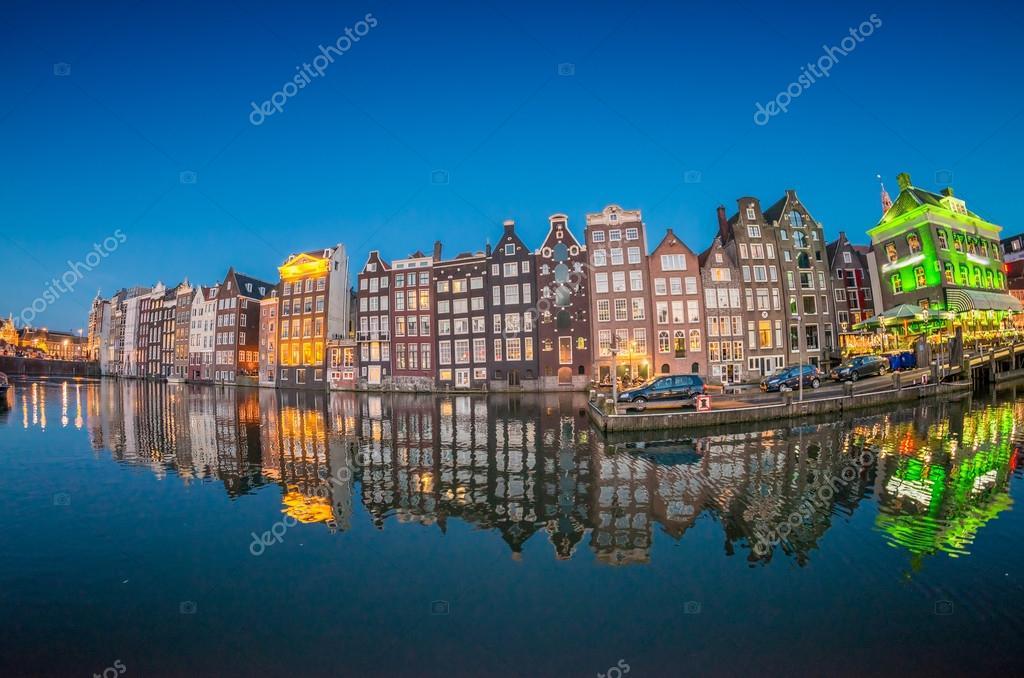 Beautiful night skyline of Amsterdam. City homes along canal