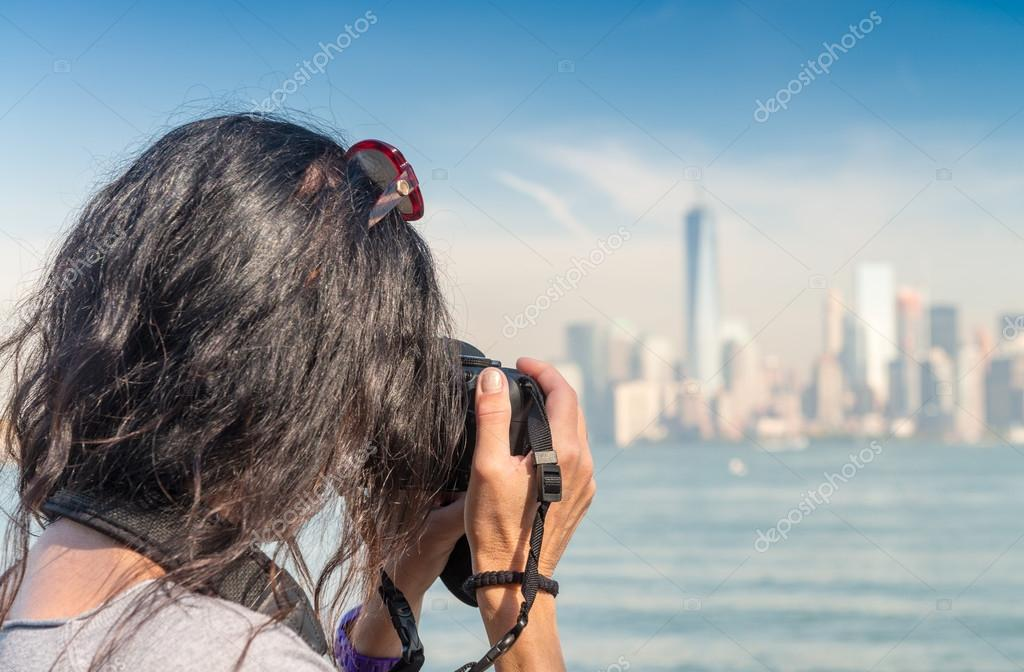 Female photographer capturing New York skyline