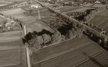 Black and white aerial view of countryside and rairoad