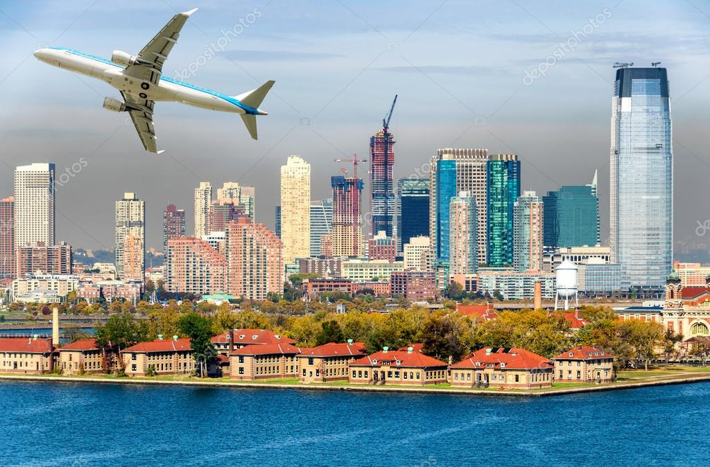 Airplane over Jersey City, NJ. Travel concept