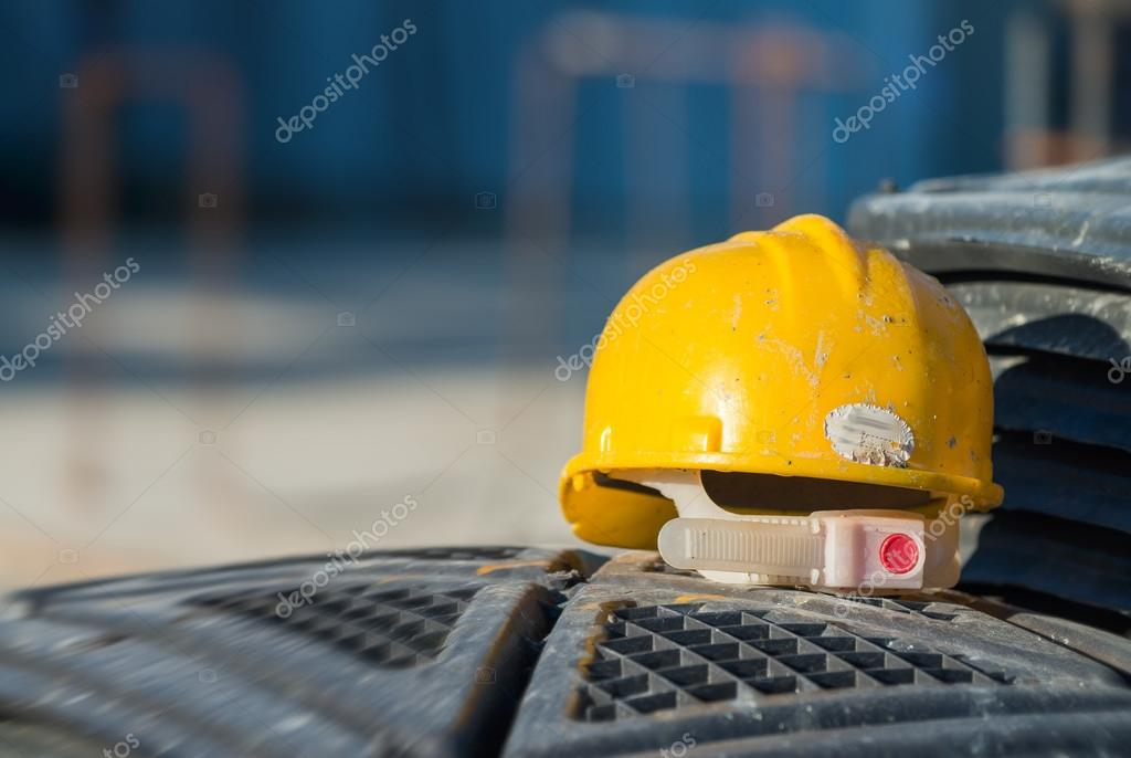 Isolated yellow worker hard-hat,natural light in construction si