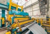 Fotografie Kaltgewalzte Stahl Spule auf Bandhaspel Maschine in Metallarbeiten BBU