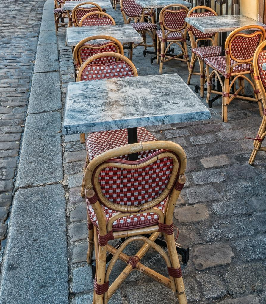 Chairs ansd tables of Montmartre. Romantic street of Paris
