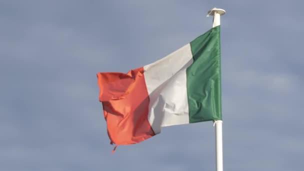 Italian flag floating on flag pole