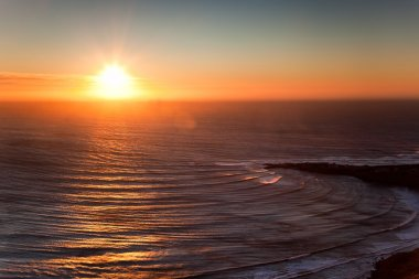 Sunset on the oceanic cost of Morocco