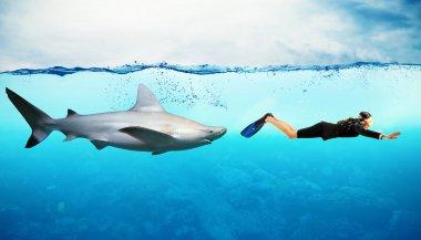 Shark swims behind a businesswoman