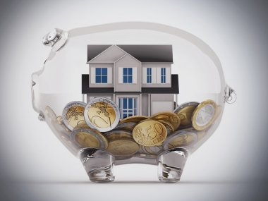 House and money in piggy bank