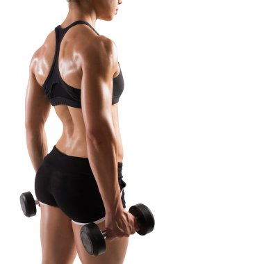 Muscular woman with dumbbells