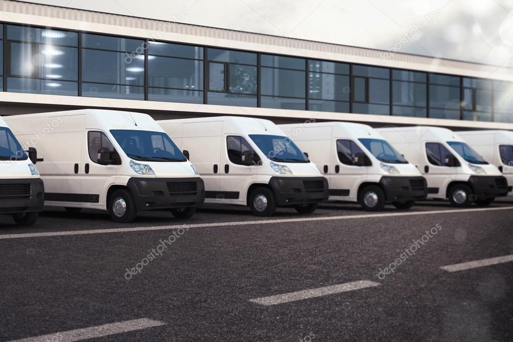 Line of white trucks